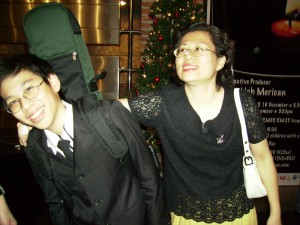 Elliot, seen here with his mum Sook Ching, plays the cello with the KLPAC orchestra.