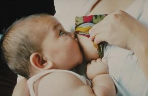 http://commons.wikimedia.org/wiki/File:Baby_aan_de_borst.jpg